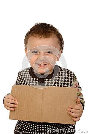 Boy holding a  cardboard