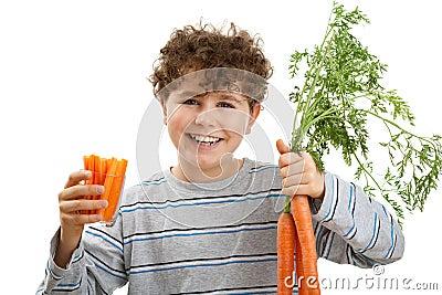 Boy holding fresh carrots