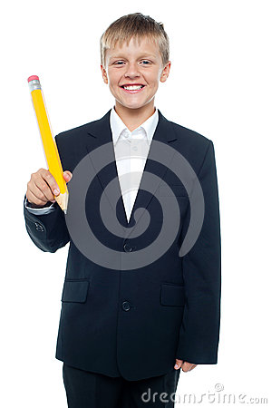 Boy holding giant sized yellow pencil