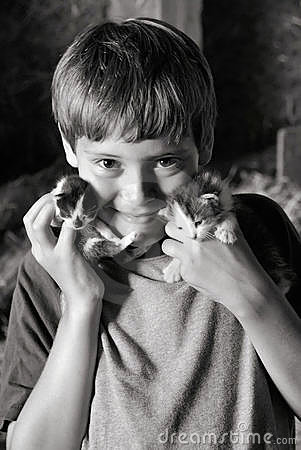 Boy holding kittens