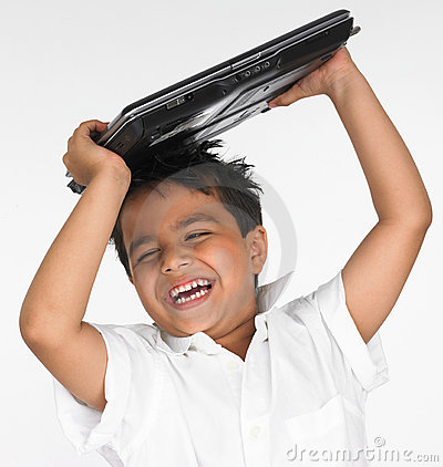 Boy holding laptop on his head