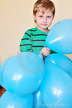 Boy Holding A Lot Of Balloons Stock Photos - Image: 13256043