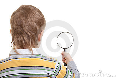 Boy holding magnifying glass