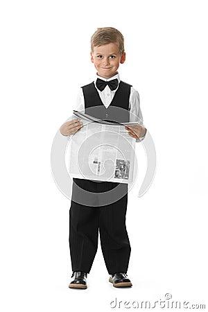 Boy holding a newspaper