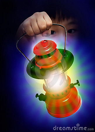 Boy holding oil lamp