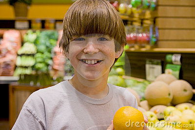 Boy Holding an Orange