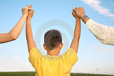 Boy holding parents hands
