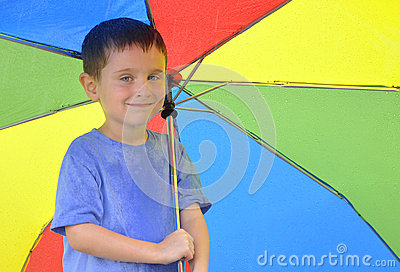 Boy Holding Rainbow Umbrella