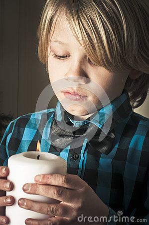 Boy holding a religious candle