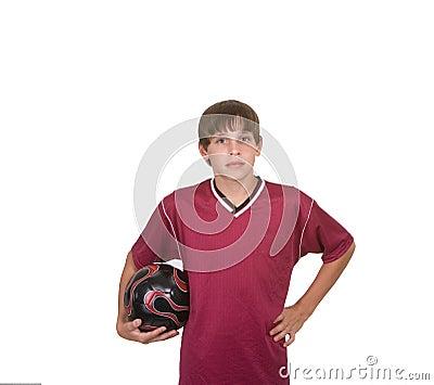 Boy holding soccer ball