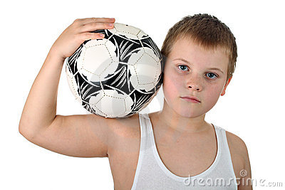 Boy holding soccer ball on his shoulder isolated