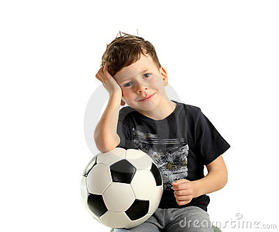 Boy holding soccer ball and recreation