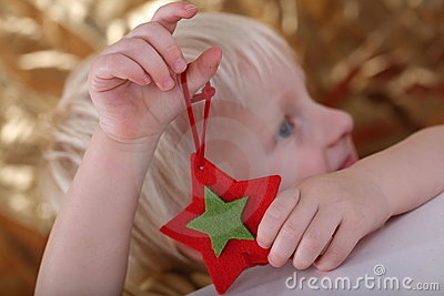 Boy holding star ornament