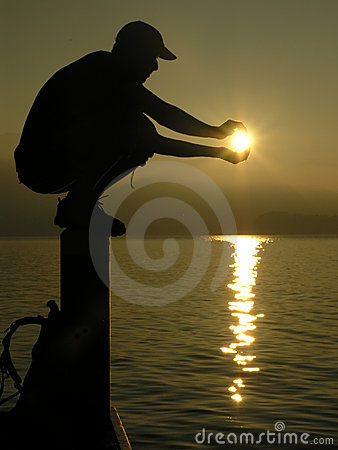 Boy holding the sun