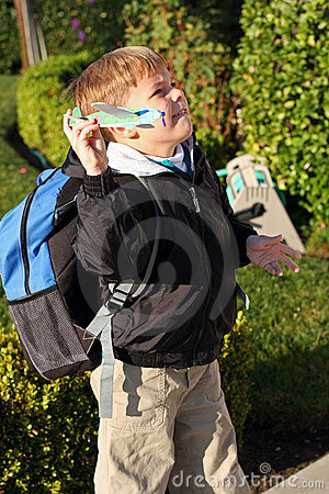 Boy is holding a toy foam airplane