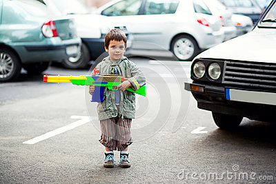 Boy holding toy rifle