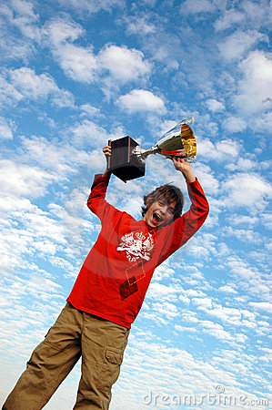 Boy holding up trophy