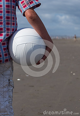 Boy holding volleyball