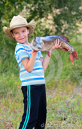 Boy holds big fish