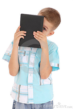 The boy holds the black book