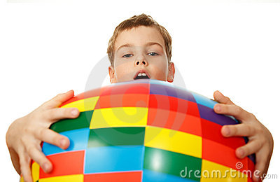 Boy holds before itself big inflatable ball