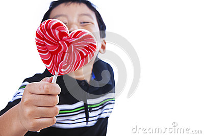 Boy holds love lollipop