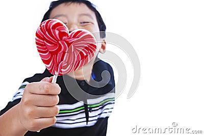 Boy holds love lollipop