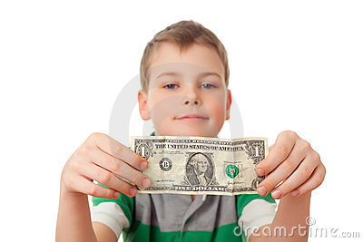 Boy holds one dollar in both hands isolated
