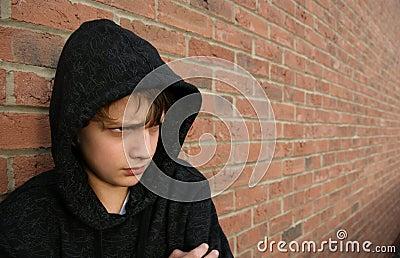 Boy in hooded top
