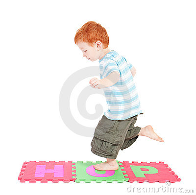 Boy hopping over word