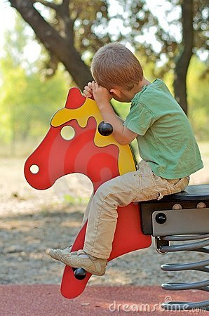Boy on a horse on a playground
