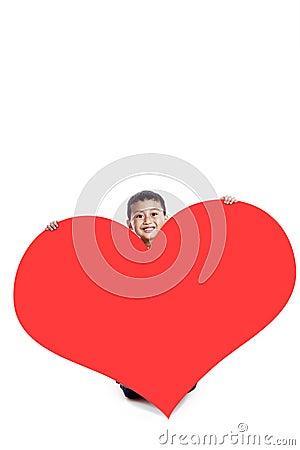 Boy with a huge heart cutout