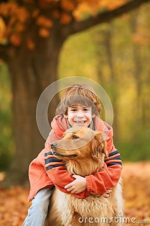 Boy Hugging the Dog