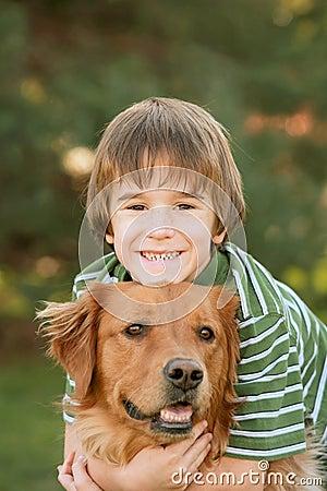 Free Boy Hugging Golden Retriever Royalty Free Stock Photos - 4602178