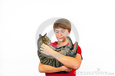 Boy hugging his tabby cat