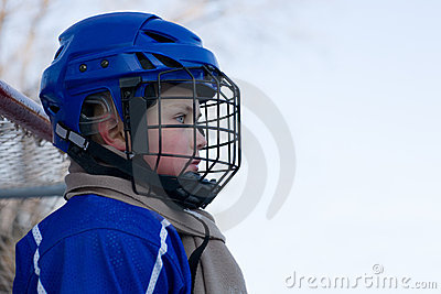 Boy ice hockey player plays hockey