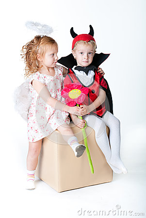 The boy in the image of devil and a girl angel