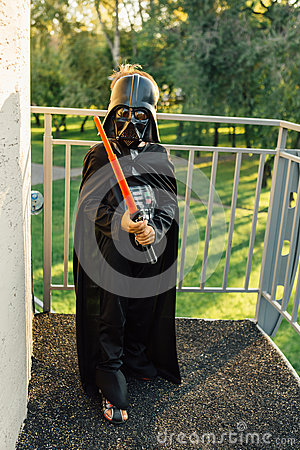 Free Boy In A Costume Of  Darth Vader With Sword. Royalty Free Stock Photos - 62619238