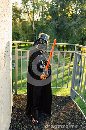 Free Boy In A Costume Of  Darth Vader With Sword. Stock Image - 62619251