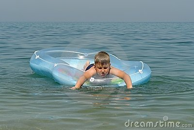 Boy in an inflatable boat