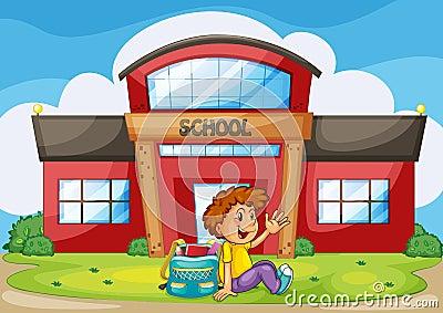 Boy infront of school
