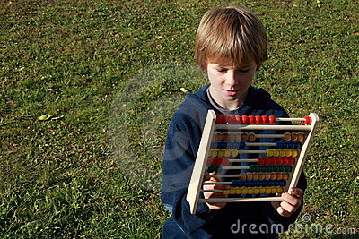 Boy interested in an abacus