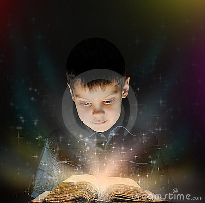 Free Boy Is Reading A Magic Book Royalty Free Stock Image - 22262486