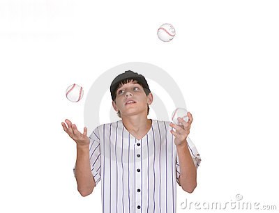 Boy juggling baseballs