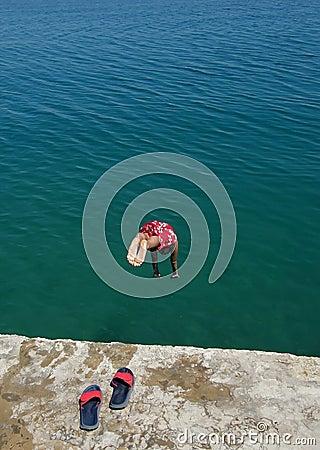 Free Boy Jump In Sea Stock Photos - 9876553