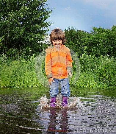 Boy jump in puddle