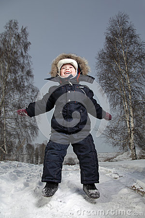 boy jump in winter outdoors