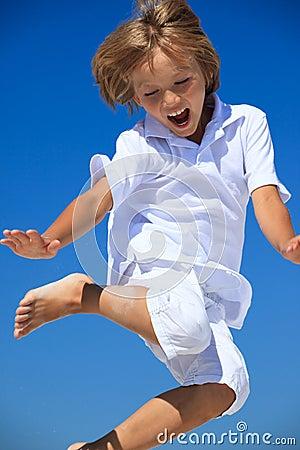 Boy jumping midair