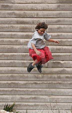 Boy jumping off building