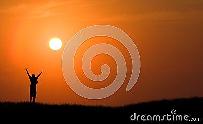 Boy jumping silhouette sunset